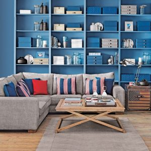 Coastal inspired living room with bold blue shelving 920x920